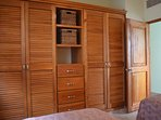 Extensive built-ins create ample storage in bedroom two.