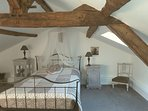 1st floor double bedroom, this room also has a large antique single bed, low feature beams
