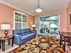 Family Room with Pull Out Couch; Entrance to Pool Area!  Desk Area for Laptop;
