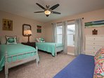 Cute, beachy motif bedroom that sleeps four adults comfortably!