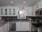 Updated kitchen with granite countertops, stainless appliances and everything you need to make meals