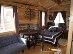 sister cabin's interior queen bed, shower bathroom, kitchenette