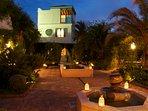 Casita and garden lit up at night.