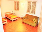 Comfy sofa & twin beds ideal for additional guests