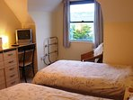 Twin bedroom with village and countryside views