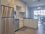 Stainless steel appliances and very exotic solid granite countertops.