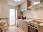 Fully equipped kitchen including Nespresso coffee machine. Laundry room with washing machine.