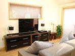 Lounge area with large flat screen TV