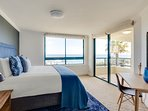 The master bedroom with sea views and king size bed