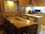 Large oak table with corner banquette