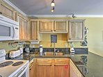 Prepare a delectable meal in this fully equipped kitchen.