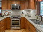 Basic kitchen amenities include dishwasher and coffee maker.