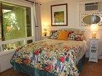 Your cozy master bedroom. Wall of windows, Queen bed and ocean views....