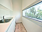 Utility room adjacent to kitchen