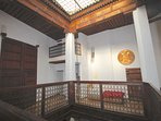 The second-floor balcony with it access to the roof and here an occasional bed for an extra guest