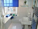 bathroom with overhead shower