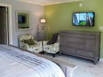 The 55' flat screen TV is visible from either the bed or the seating area.