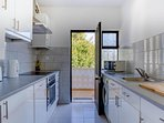Fully fitted kitchen with door to the outside...