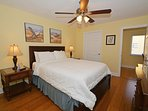Nice spacious bedroom with solid dressers and walk-in closet space.