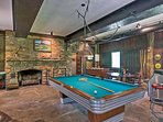 Basement game room w/ wood fire place and widescreen TV