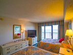 Relax and enjoy TV in the master bedroom after busy vacation days.