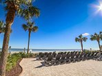 Lots of lounge chairs on an oceanfront patio to soak up the sun without the sand.
