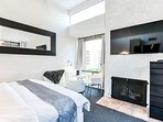 Master bedroom overlooking golf course, private balcony, 60 inch Smart TV