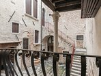 there is a small 'Romeo & Juliet' kind of balcony facing the charming courtyard of this Palazzo