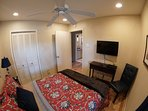 Full Size Bed, 32' TV, DVD Blu-Ray Player and Chair for Add Comfort with View of Hall Bathroom