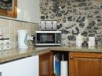 Stone and flint kitchen wall.