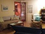 Large window-lined sunroom/family room.