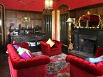 The second sitting room offers a more traditional and cosy space