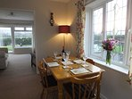 The spacious dining room has lovely views over the patio area and gardens.