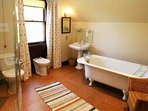 This first floor bathroom has a roll top bath and shower cabinet