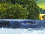 The hot tub looks out over the beautiful Scottish landscape