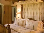 The Ruthven Suite has a super king double half tester bed