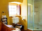 Luxury bathroom with shower and feature copper tub, en-suite for Erskine Suite