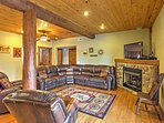 Relax in one of the comfortable living areas, complete with a stone fireplace.
