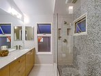 His and Her Bathroom with stone glass shower is off the master bedroom.