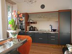 kitchen area / stove, microwave oven and coffee machine cupboards