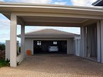 Covered driveway leading to the front door (left side of photo)... a two car garage is available