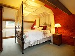 Upstairs - large bedroom with a fantastic king size 4 poster bed.