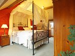 King size 4 poster bed in one of three bedrooms at Ysgubor Llyn cottage
