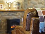 Relax on the comfy sofas in front of the electric fire stove and a good DVD