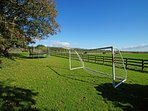 Garden includes BBQ set, football goal, playhouse & fantastic trampoline