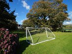 Garden includes BBQ set, slide, football goal, playhouse and trampoline