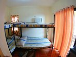 Downstairs Air conditioned bedroom with uretex mattress, Sleeps 8