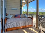 Daybed just off of the Screened Balcony of Shaw Shack! Enjoy the Lake Views and fresh air coming in from the Beautiful ...