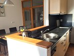kitchen with  fridge,stove, oven, microwave coffee maker hot water kettle  and dishwasher!!