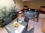 Al fresco dining, surround sofa and bubble spa